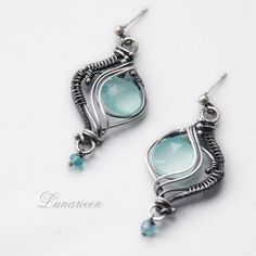 This pale aqua color is stunning with the antiqued silver wire! PHAREELITH by LUNARIEEN.deviantart.com