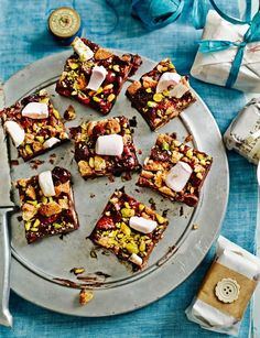 Grown-up rocky road - it's just too good for the kids. Dried morello cherries, amaretti biscuits, pistachios, marshmallows and ginger. http://www.sainsburysmagazine.co.uk/recipes/desserts/chocolate/item/grown-up-rocky-road