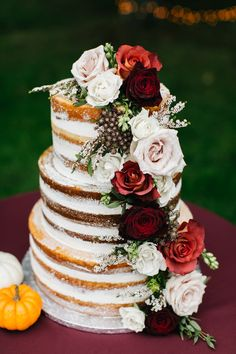Naked wedding cake, red and pink roses, cascading flowers // Emily Wren Photography