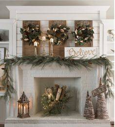 Love the wood with fir branches and lights in the fireplace