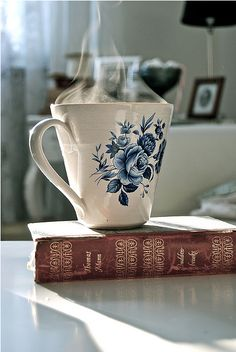 A book with a hot drink in a beautiful cup.