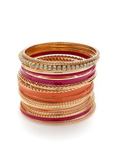"""** This set could work many ways! **  Set Of 19 Gold & Crystal Bangle Bracelets by Cara Couture Jewelry on Gilt.com • Twisted gold tone base metal, purple/fuschia and orange tone base metal, crystal bangles. • 2½"""" diameter • Entire set 3"""" wide on arm • Imported"""
