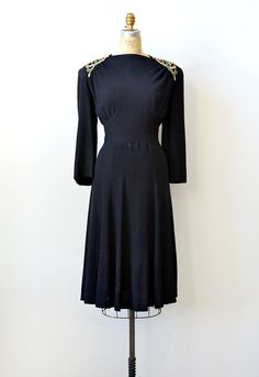 Vintage late 1930s plus size black rayon dress with gorgeous embroidery on shoulder yokes. Ruched bodice, slightly flared skirt, buttons up the side with hidden placket and buttons on the back.