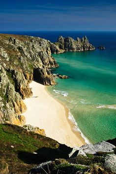 PEDN VOUNDER BEACH, Cornwall, [ENGLAND] Romantic moments with the husband. One of the most stunning tidal beaches in Cornwall Pedn Vounder is hidden at the bottom of a challenging, vertiginous cliff path. Not for the faint-hearted the route begins in the village of Treen. Walk past the campsite through heather and gorse shrub land and begin a rocky descent to the beach below. The beautiful lagoon is more than worth the effort.