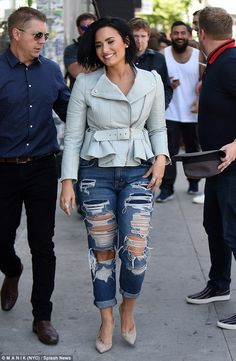 Rip-roaring good time: The 23-year-old singer looked Confident in ripped jeans with a chic...