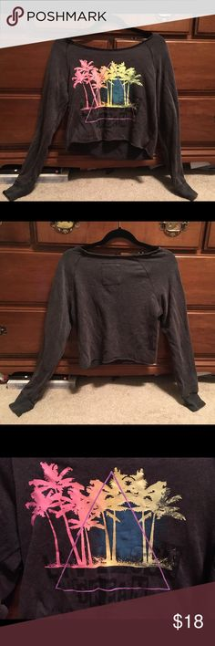 Grey Sweater Crop Top Grey sweater off the shoulder crop top with neon palm tree and triangle design with black lettering on bottom. Has been worn but still in great condition with only slight pilling in some areas. Aero Tops Crop Tops