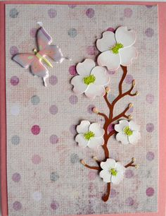Simple; a purchased flower spray on a pretty coordinated paper; add a butterfly sticker...