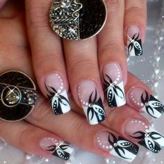 The classic french manicure is updated by adding some abstract designs. Watch the video to get some intricate and  fabulous nail art inspiration.