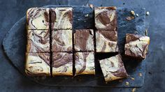 "These fudgy ""black and white"" brownies are marbled with an orange-scented cheesecake. Perfect with a cuppa or after dinner pick-me-up. Recipe from  Anneka Manning. Check out our Bakeproof column for tips and recipes."