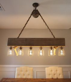 The Joshua Chandelier is a unique rustic, farmhouse design. Similar to The David Chandelier, it is most suitable for islands, bar tops, and dining spaces. This handmade light fixture features a barn p Rustic Light Bulbs, Rustic Light Fixtures, Dining Room Light Fixtures, Rustic Chandelier, Rustic Lighting, Home Lighting, Farmhouse Dining Room Lighting, Farmhouse Design, Rustic Farmhouse