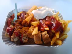 Currywurst - Steamed and Fried Bratwurst with curry ketchup and powder, sometimes mayo, and fries or a roll (Germany)