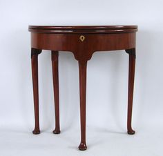 Narrow Demilune Console Tables C915-4   A George II mahogany tilt-top table, the large dish top above ...