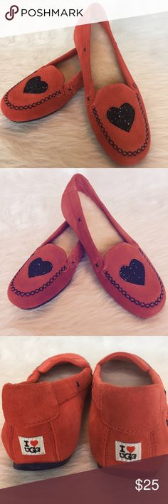 Authentic UGG Suede Moccasins NWT-I ❤️ UGG Brand Authentic cozy slipper shoe with fuzzy lambs wool lining. Brick colored suede with cute navy glitter hearts. Never Worn-Perfect for inside or out... NWT. Size 6. No Trades. TB1261. UGG Shoes Moccasins