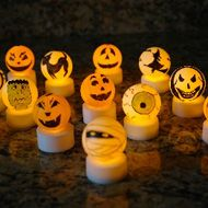Light Up Hallowen Crafts*****Ping Pong balls and battery powered tea lights.
