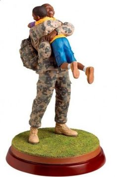 """A new African-American figurine by the talented Thomas Blackshear named """"Coming Home"""". You can feel the love in this piece. Great job Thomas!"""