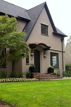 Taupe stucco with black accents | pretty home exterior | landscape