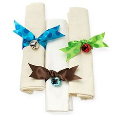This would be so cute on the buffet table at our annual Cookie Exchange. *Ring-a-Ding: Create a jolly napkin ring. Simply thread a jingle bell onto a piece of ribbon, wrap around the napkin, and knot. Trim edges.