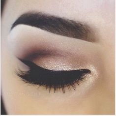 Gold smokey eye and bold brows