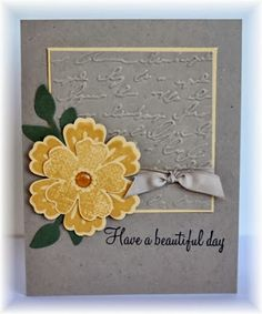 Scrappin' and Stampin' in GJ.  Like the embossed panel behind the flower.