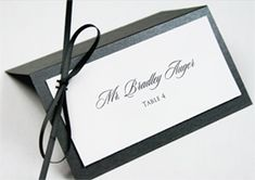 These placecards...red plain place card, ivory cardstock and black, ivory and red ribbons to signify dinner option.