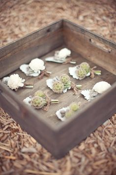 Boutonnieres made of balsa wood flowers, scabiosa pods, silver brunia berries and gray dusty miller leaves…all finished in rustic twine