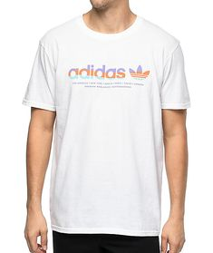 "Add soft color to your simple white tee look with the Linear shirt from adidas. An all white 100% cotton tee features striped ""adidas"" print in purple, orange and teal on the front."