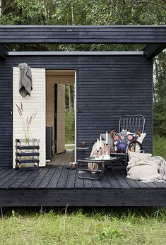 Black with white - Swedish cottage studio deck. Black cane chair - the original inspiration for Ikea's Storsele chair?