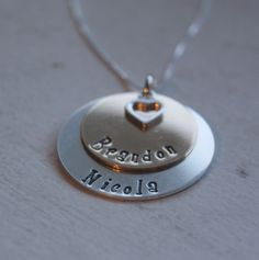 "Personalized Sterling silver and 14k Gold Hand stamped necklace with heart two toned "" Can do this with 3 discs too. $65.00, via Etsy."