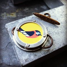 """Modern Bird Tin discs are riveted together using steel Screw Rivets, pewter spacers Brass jump rings and toggle bar- Vintaj Brass Co.  Measurement: Upper outside Disc- 1-3/8"""""""
