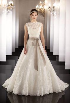 Brides: Martina Liana�- 2013. Style 437, sleeveless silk organza and lace A-line wedding dress with a high neckline, keyhole back, and ribbon belt, Martina Liana