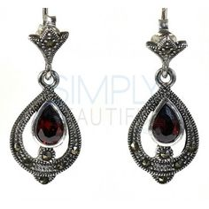 Natalie Garnet and Marcasite Earrings - a  pear shaped facet cut deep red garnet is set in polished silver with a polished and antiqued silver pear shaped frame surrounding the stone. The pear shaped frame and the face of the post is outlined with lined silver and filled in with polished silver beads and marcasite accents. These handcrafted earrings are composed of .925 sterling silver.  http://simplybeautiful2012.com/natalie-garnet-and-marcasite-earrings.html#