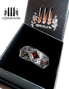 silver gothic wedding ring with garnet stone Skull Rings
