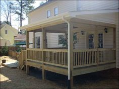 This pressure treated porch replaced a deck that was in disrepair. It has a shed style roof, beaded vinyl siding and dimensional shingles to match the ex(...)