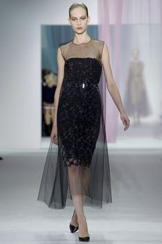 Christian Dior Spring 2013 RTW this dress is interestingly feminine, the layered tulle adds an element of excitement to the classically chic idea of a little black dress-Runway