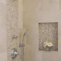 use the accent wall tile for cut out/built-n shelving on shower