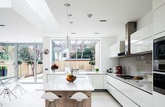 © All photographs by David ButlerEye-opener: the use of roof lights and of white and translucent chrome furniture make the kitchen/dining room seem huge (garden lighting plan side return) Kitchen Design Open, Open Plan Kitchen, New Kitchen, Island Kitchen, Awesome Kitchen, Kitchen Sink, Kitchen Interior, Kitchen Decor, Kitchen Ideas