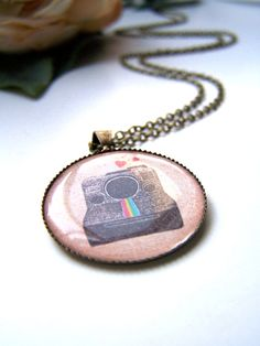 ...perhaps for the Instagram users.. the vintage polaroid pendant necklace by barberryandlace on Etsy