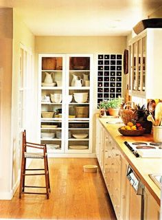 Artfully designed built-in storage at end of galley kitchen