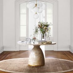 Shop entryway tables and more at Williams-Sonoma Home. Discover elegant entryway furniture, decor, and more to create a good first impression of your home. Decor, Table, Foyer Decorating, Round Table Decor, Foyer Design, Dining Room Lighting, Stone Entryway, Foyer Table Decor, Entryway Furniture