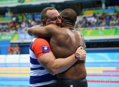 Lorenzo Perez Escalona of Cuba celebrates winning the gold medal with his coach in the Men's 100m Freestyle - S6 Final on day 10 of the Rio 2016 Paralympic Games at the Olympic Aquatic Stadium on September 17, 2016 in Rio de Janeiro, Brazil.