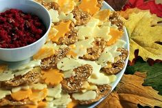 Clever fall appetizer. Create a wreath of cheese slices cut into leaf shapes arranged with crackers.