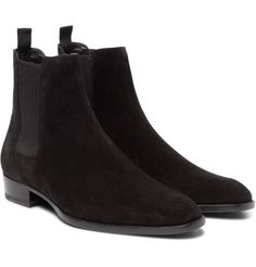 Chelsea boots are appreciated for their sleek profile, and this pair by <a href='http://www.mrporter.com/mens/Designers/Saint_Laurent'>Saint Laurent</a> is a fine case in point. They've been made in Italy from tactile black suede and are set on subtly height-enhancing 30mm heels. Grosgrain pull tabs and elasticated inserts ensure they're comfortable and easy to slip on and off. Team them with a pair of the brand's skinny jeans...