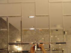 Beveled mirror subway tile {set in herringbone}