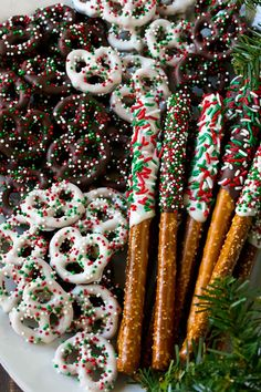 Chocolate covered pretzel twists and rods on a serving platter. Christmas Pretzels, Easy Christmas Treats, Christmas Deserts, Christmas Chocolate, Christmas Goodies, Holiday Desserts, Christmas Candy, Holiday Baking, Holiday Treats