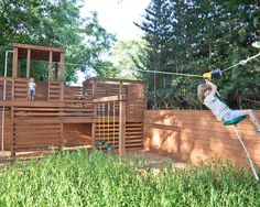 Construct play structure at end of yard so it doubles as fencing to maximize space