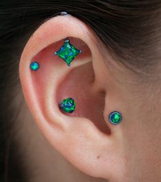 Multiple Ear Piercings for the Bold Ones - Emerald Green Tragus Earring, Cartilage Piercing, Helix Ring, Conch Stud at MyBodiArt