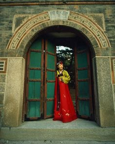 Seoul, South Korea - beautiful woman wearing a traditional hanbok framed in an arched doorway. Sigh.
