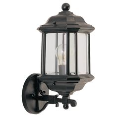 The+Kent+one-light+outdoor+wall+lantern+is+crafted+in+die-cast+aluminum+for+added+durability+to+weather+conditions.+The+traditional+styling,+black+finish+and+clear+beveled+glass+combine+for+a+classic+look+that+coordinates+with+many+home+designs.