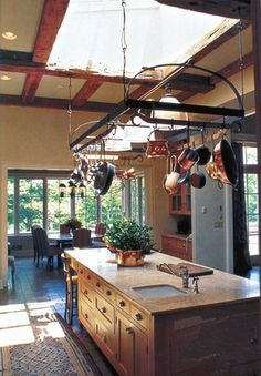 Mountainville, NJ residence. Kitchen with island countertop, hanging pots rack, skylight.
