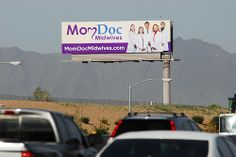 Billboard for MomDoc Midwives on the Santan Freeway Loop 202.  MomDoc Midwives www.MomDocMidwives.com Drs. Goodman & Partridge, OB/GYN Beautiful Beginnings Partnering with you for a healthy pregnancy and a healthy baby. To schedule an appointment ple (Learn a Little-Known, But 100% Scientifically-Proven Way To ERASE Your Diabetes in 3 SHORT weeks)